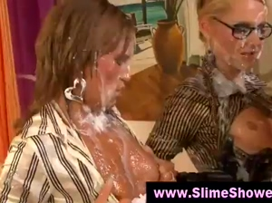 Babes take wet and messy cum shower