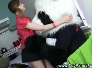 Teen girl teases her toypanda with her body