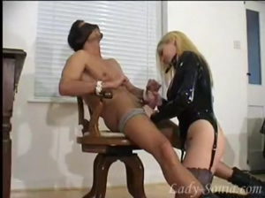 Blonde wearing Latex jacket pleases slave in front of her mistress