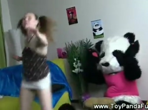 Teen girl shows her toypanda her dancing moves