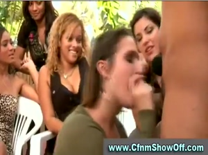 Brunette sucks off CFNM guy at a CFNM party