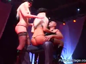Twin strippers teas on stage