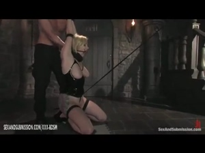 The man dominates on bondage blonde babe in latex