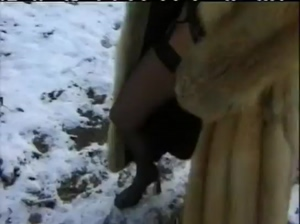 Woman Peeing In The Snow