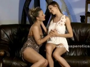 Pair of teen lesbian babes kissing